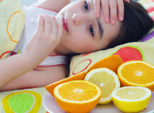 Sick little girl. And takes fever royalty free stock image