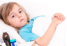 Sick little girl in bed Royalty Free Stock Photos