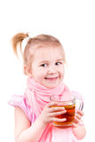 Sick little girl with chickenpox drinking tea with lemon Royalty Free Stock Image