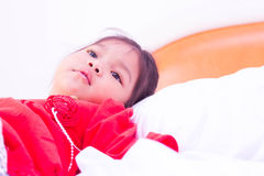 Sick little girl lying in the bed Royalty Free Stock Photo