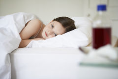 Sick Little Girl Lying In Bed Stock Photos