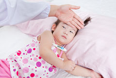 Sick little girl nursed by a pediatrician Royalty Free Stock Images