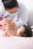 Sick little girl nursed by a pediatrician Royalty Free Stock Photography
