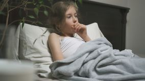 Sick little girl. Sick little girl coughing lying in the bed stock footage