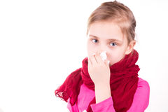 Sick little girl sneezing with napkin Royalty Free Stock Photo