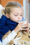 Sick little girl suffering of cold and lying in bed Royalty Free Stock Photo