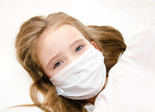 Sick little girl with surgical face mask for bacterial and virus Stock Images