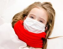 Sick little girl with surgical face mask for bacterial and virus Royalty Free Stock Photos