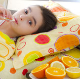 Sick little girl with a thermometer in bed. Sick little 7 years old girl with a thermometer in bed stock images