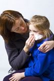 Sick little girle. Sick litle girl on her mother knees Royalty Free Stock Images