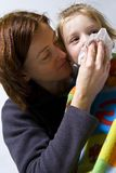 Sick little girle. Sick litle girl on her mother knees Stock Photo