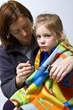 Sick little girle. Sick litle girl on her mother knees Stock Photos