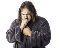 Sick looking man. Isolated sick man bundled up in a robe coughing Stock Images