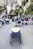 Sick in lourdes praying Royalty Free Stock Image