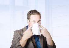 Sick male office worker with cold and flu virus Stock Photography