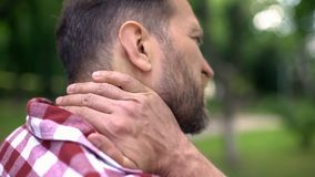 Sick male touching neck, suffering from strong spasm, spinal discomfort, pain royalty free stock images