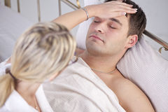 Sick man in bed stock images
