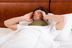 Sick man in bed Royalty Free Stock Photo