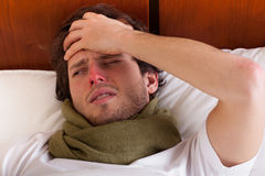 Sick man in bed Stock Image