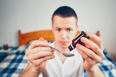 Sick man in bedroom Stock Photo