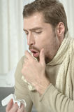 Sick man blowing his nose Royalty Free Stock Photography