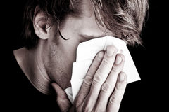 Sick man blowing nose Royalty Free Stock Photos