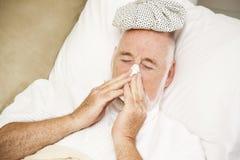 Sick Man Blows Nose Stock Photos