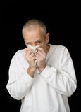 Sick Man with Cold holding handkerchief Royalty Free Stock Image