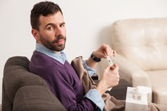 Sick man with a cold and some fever Stock Photo