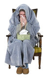 Sick Man With Cough, Cold, Flu Isolated. A sick man with a cough, cold, or flu is ill and sits in a chair with a box of his kleenix facial tissue. The male use Stock Image