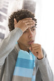Sick man, cough man, with flu. Ill man with scarf caught Stock Photo