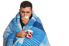 Sick man coughing and holding a warm tea cup Royalty Free Stock Photos