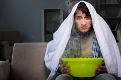 The sick man doing inhalation at night in home Stock Images