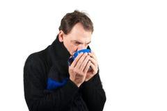 Sick man drinks tea Stock Photography
