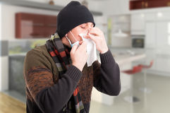 Sick man with flu blowing nose Royalty Free Stock Image