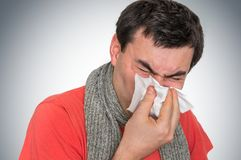 Sick man with flu or cold sneezing into handkerchief. Cold and flu concept Royalty Free Stock Photo