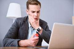 Sick man going to take pills. Stock Photography