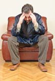 Sick man with headache or problems sitting Royalty Free Stock Photography