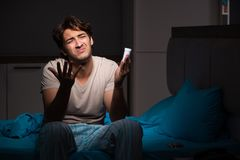 The sick man in his bed with medicines. Sick man in his bed with medicines stock photos