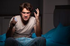 The sick man in his bed with medicines. Sick man in his bed with medicines royalty free stock photo