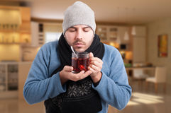Sick man holding a warm cup of tea Royalty Free Stock Image