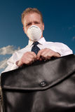 Sick man holds briefcase Royalty Free Stock Photography