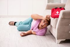 The sick man at home with first aid kit stock images