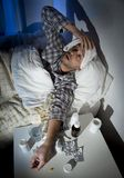 Sick man lying in bed with headache suffering cold and winter flu virus Stock Images