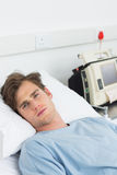 Sick man lying in hospital bed Royalty Free Stock Photos