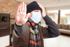 Sick man with protection mask against flu Stock Photo