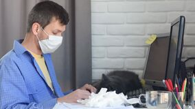 A sick man in self-isolation mode put on a medical mask and began work remotely