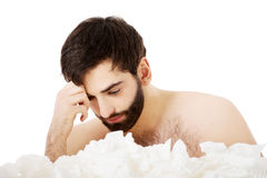Sick man sitting with a lot of tissues. Stock Images