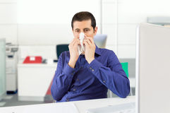 Sick man sneezing Royalty Free Stock Image