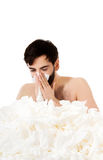 Sick man sneezing into handkerchief. Royalty Free Stock Photos
